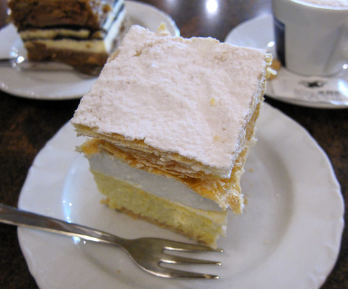 Lake Bled creamy cake. Kremna rezina is one of the most popular Slovenian desserts. It's made with a golden buttery crispy crust, vanilla cream, whipped cream, and another crispy layer of buttery dough that's all dusted with a rich layer of sugar icing.