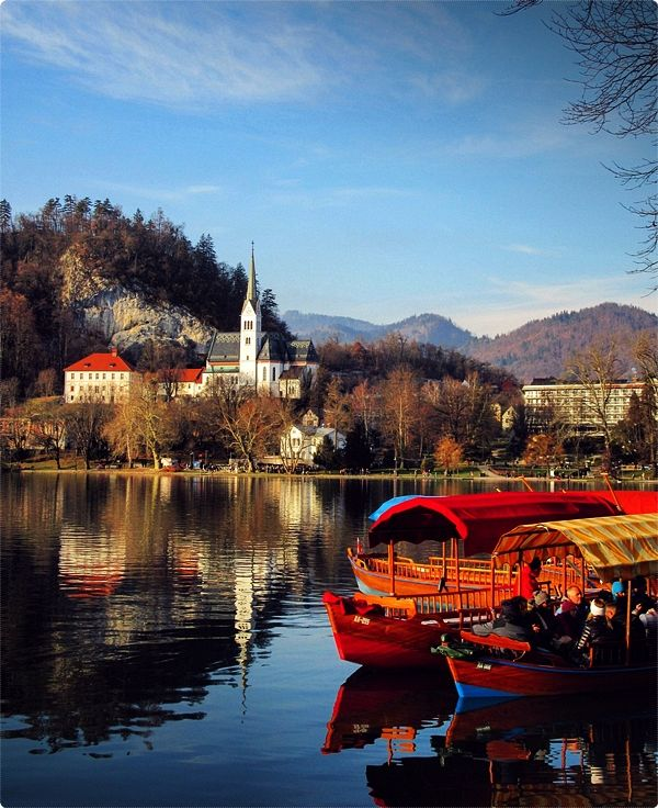 Lake Bled. Taking an old-fashioned wooden Pletna boat to Slovenia's biggest (and only) island in the center of the lake is a thing you can't skip.