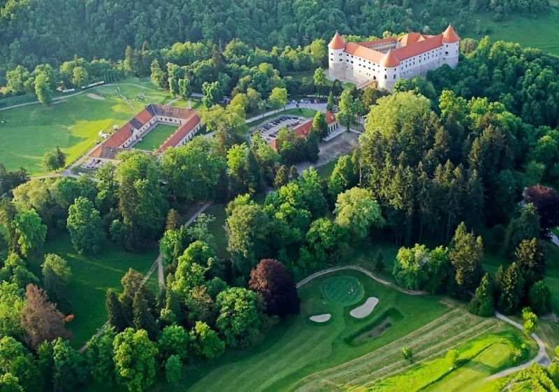 Surrounded by an 18-hole golf course, Hotel Golf Grad Mokrice is housed within a medieval castle set on a hill overlooking the green countryside.